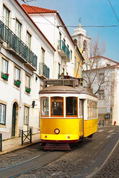 yellow 28 tram in alfama, lisbon, portugal - eletrico lisboa imagens e fotografias de stock