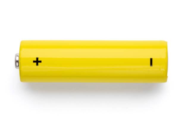 Yellow AA alkaline battery on white background stock photo