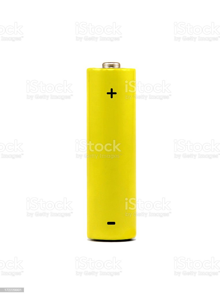 A yellow AA battery on a white background stock photo