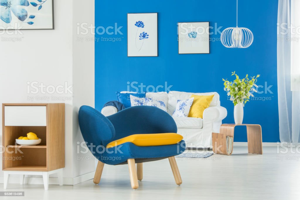 Yellow accents in blue room stock photo