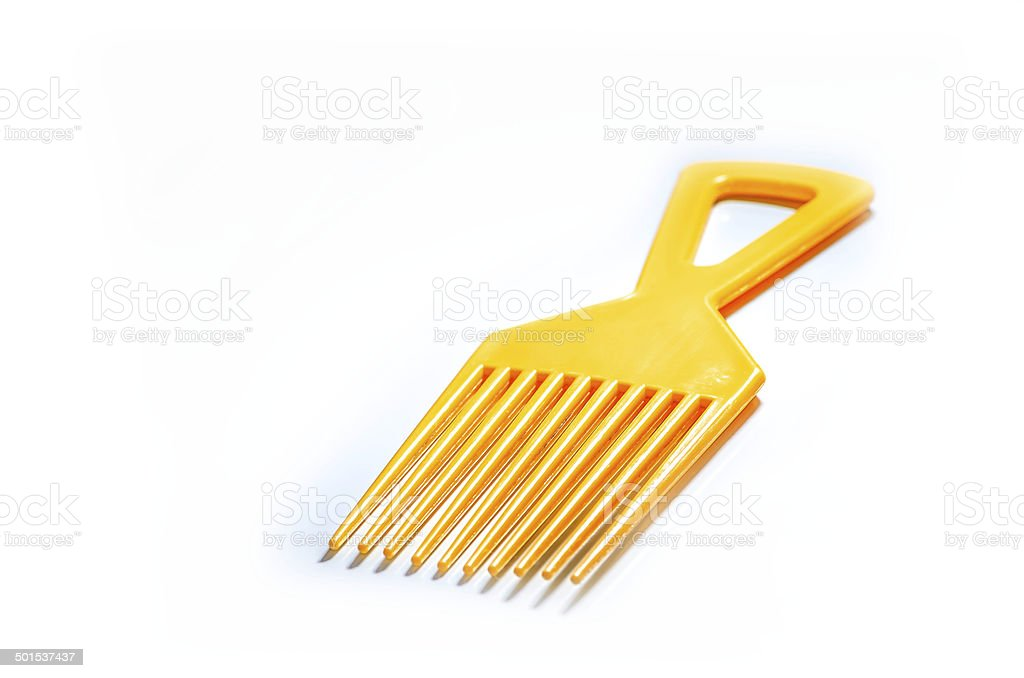 yellow afro comb, isolated on a white background stock photo