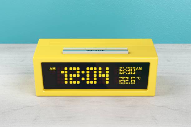 yellow alarm clock - alarm clock stock photos and pictures