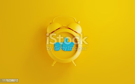 istock Yellow Alarm Clock with Thumbs Up Icon  on Yellow Background 1175238012