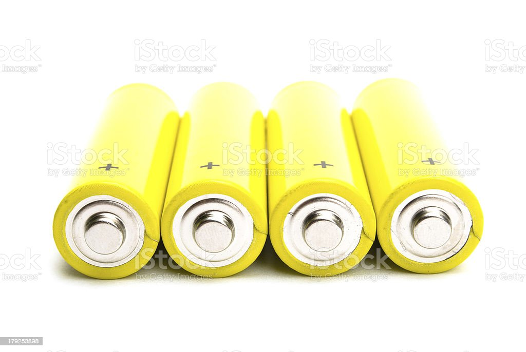 yellow alkaline batteries isolated on white background stock photo