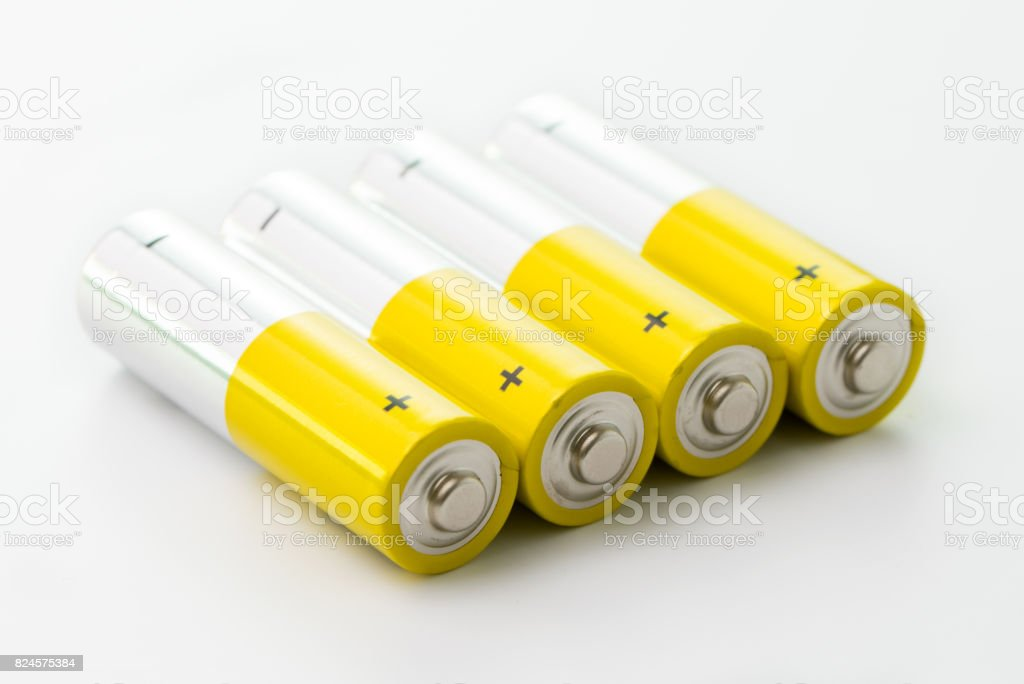 Yellow alkaline batteries stock photo