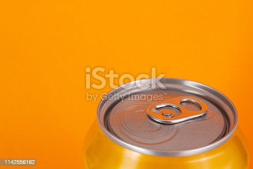 istock Yellow aluminum can on orange background with copy space 1142556162