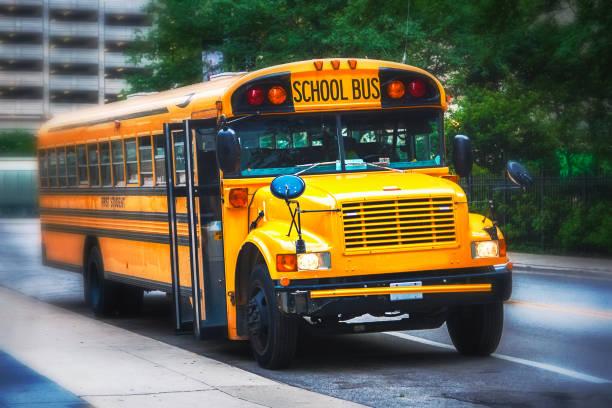 Yellow american school bus stock photo
