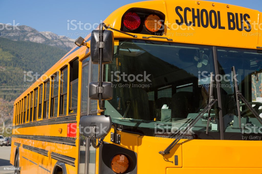 Yellow american schoolbus background closeup stock photo