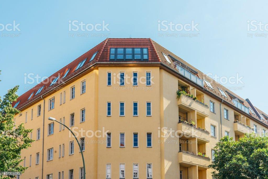 yellow and big corner house at germany stock photo