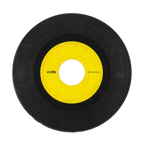 yellow and black 45 music record with scratches - records stock photos and pictures