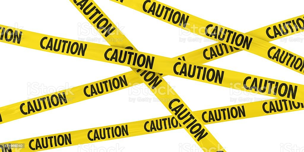 Yellow and Black CAUTION Barrier Tape Background stock photo