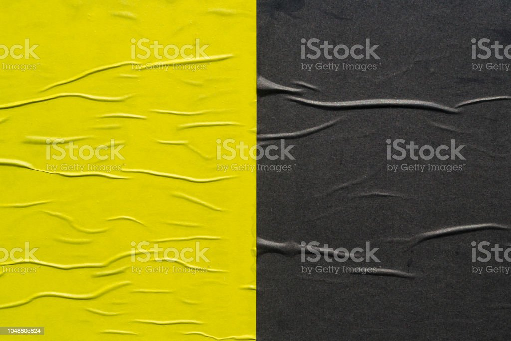 Yellow and black creased poster texture stock photo
