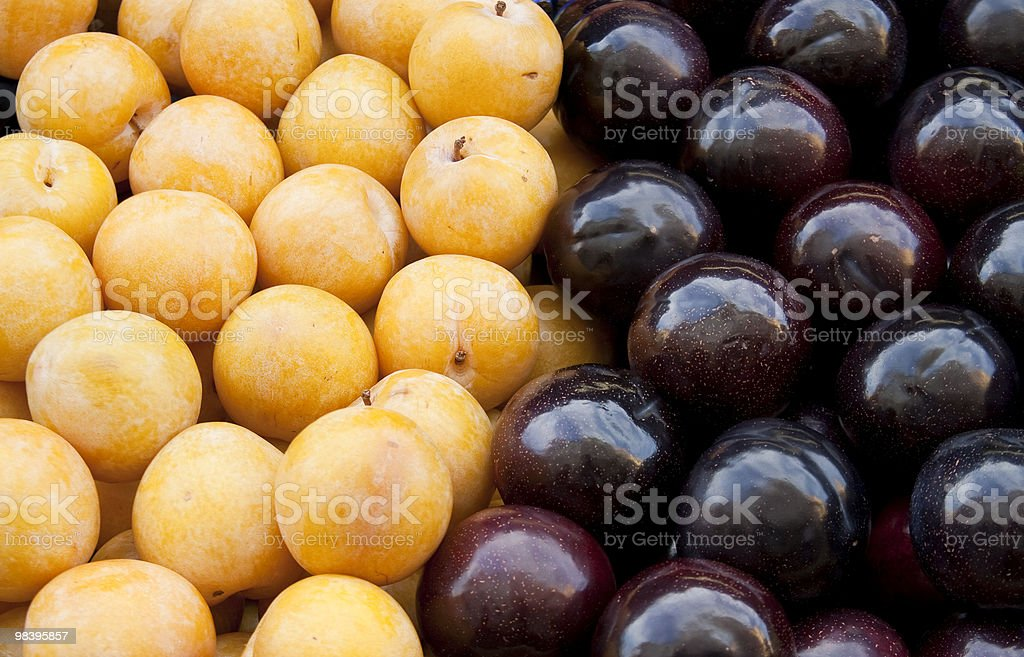 yellow and black plum fruit royalty-free stock photo