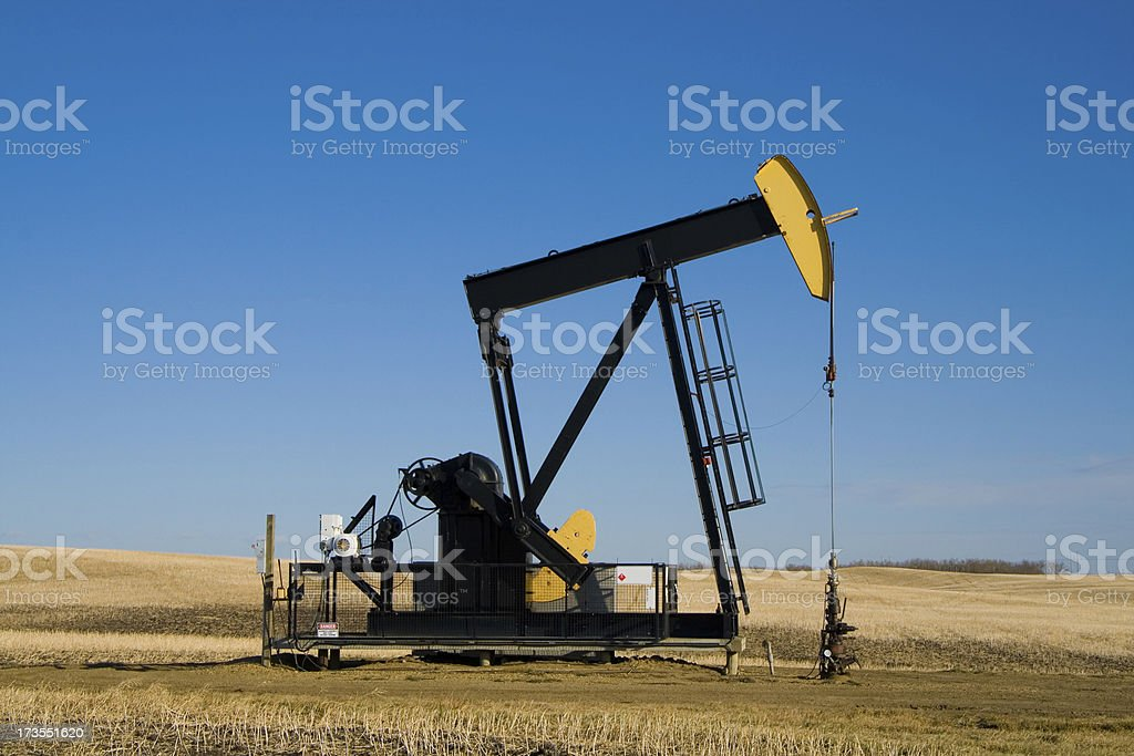Yellow and Black pumpjack royalty-free stock photo