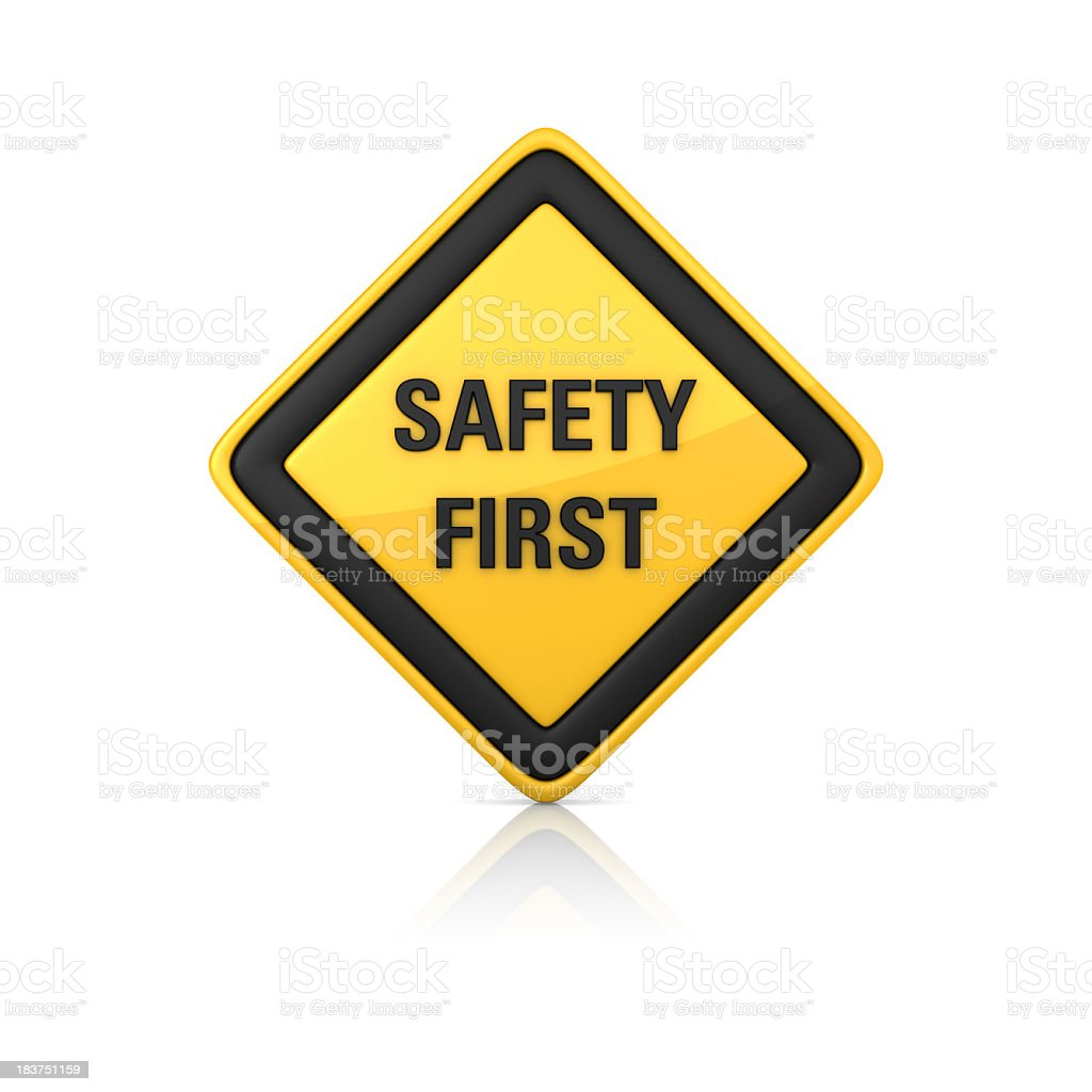 Yellow and black safety first warning sign royalty-free stock photo