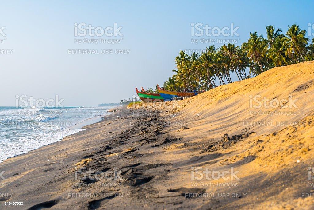 Yellow and black sand beach stock photo