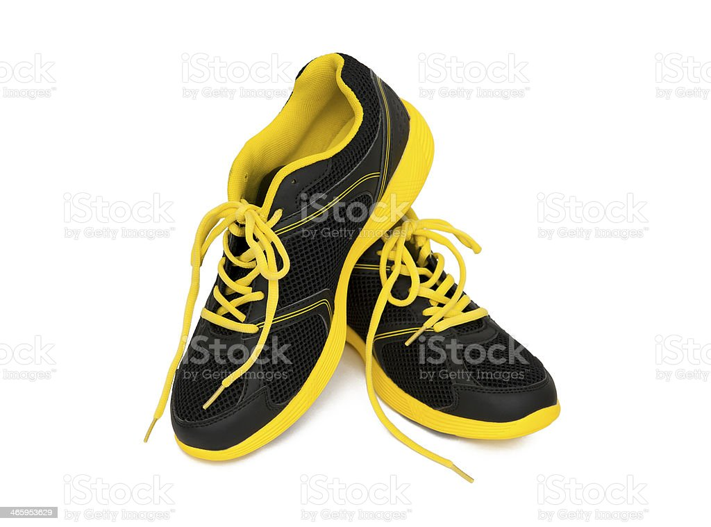 Yellow and black sport shoes against white background