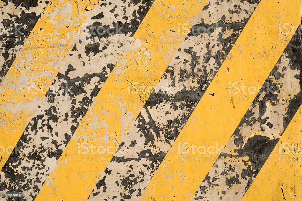 Yellow and black stripes on the concrete surface stock photo