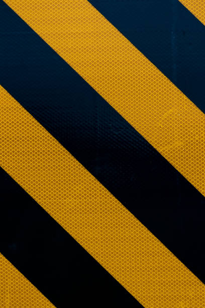 Yellow and black warning sign stripes stock photo