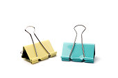Yellow and blue Binder clip on a white background.