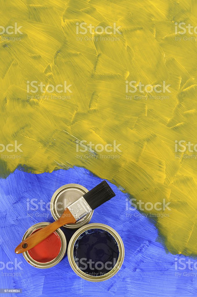 Yellow and blue floor with paint tins royalty-free stock photo