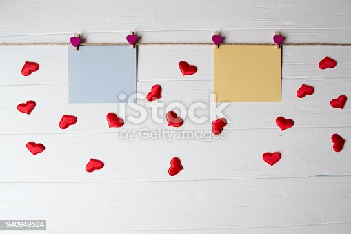 istock Yellow and blue memo sheets fastened with a decorative pins on a white wooden board. 940949524