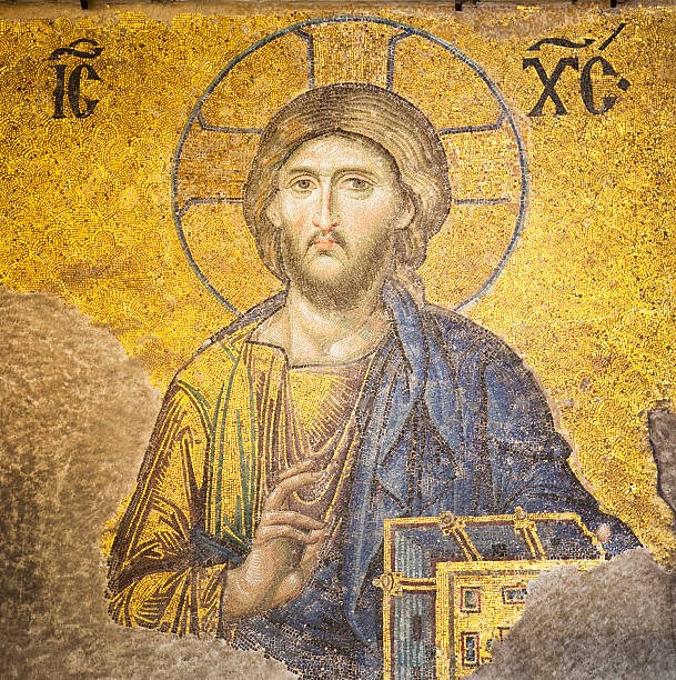 A yellow and blue mosaic of Jesus Christ stock photo