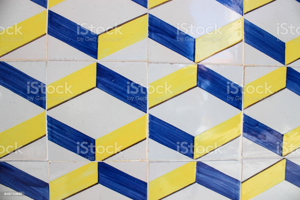 Yellow and blue painted tiles from a Lisbon building stock photo