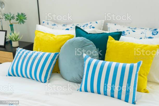 Yellow and blue pillows on white bed at home picture id1173364906?b=1&k=6&m=1173364906&s=612x612&h=fp3ybbwvp2fefrnd9nq0okv8u5njnb0c7f yucuwszo=