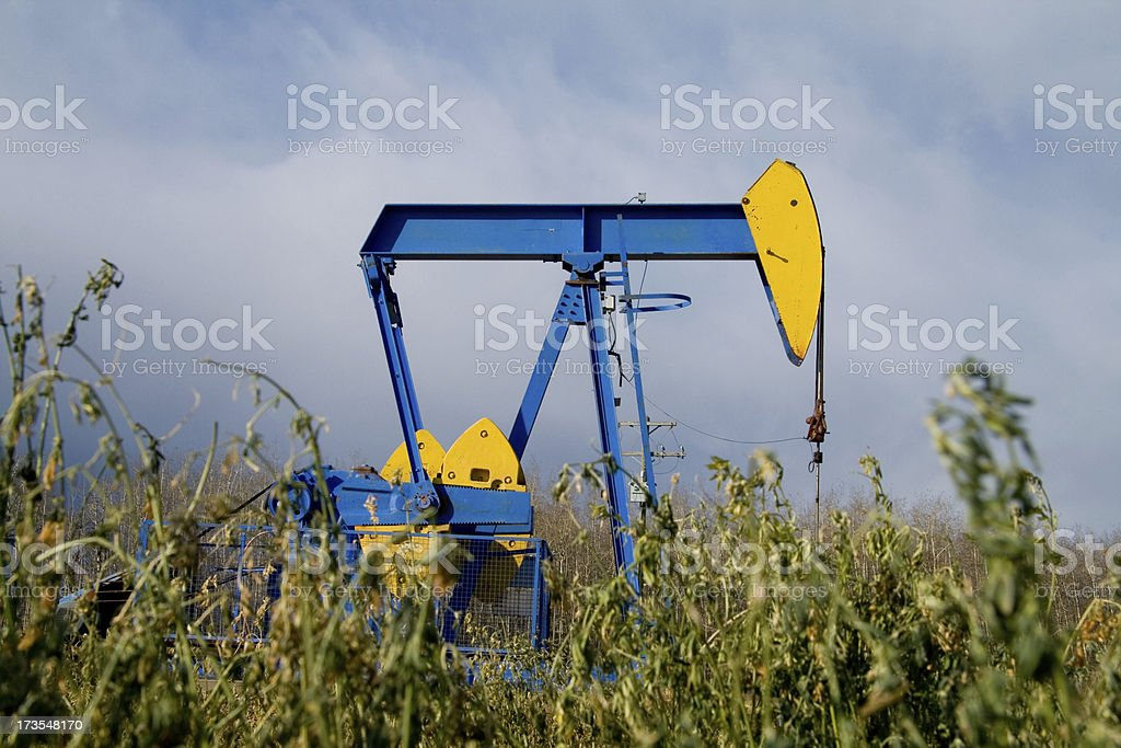 Yellow and blue pump jack royalty-free stock photo