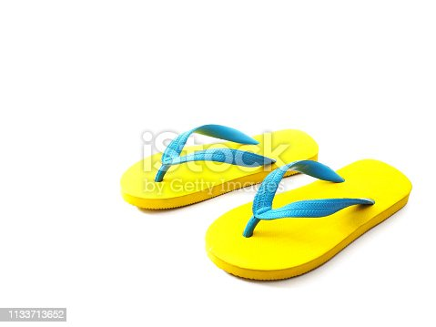 istock yellow and blue rubber flip flop shoes 1133713652