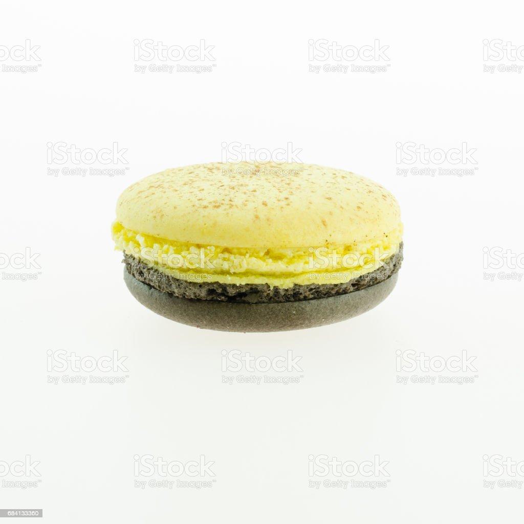 yellow and brown macaron on white background royaltyfri bildbanksbilder