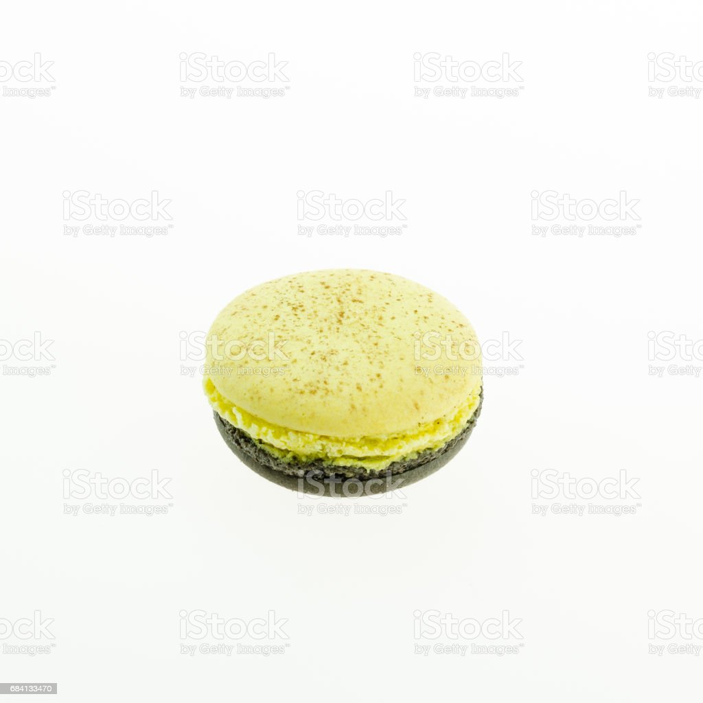 yellow and brown macaron on white background foto stock royalty-free