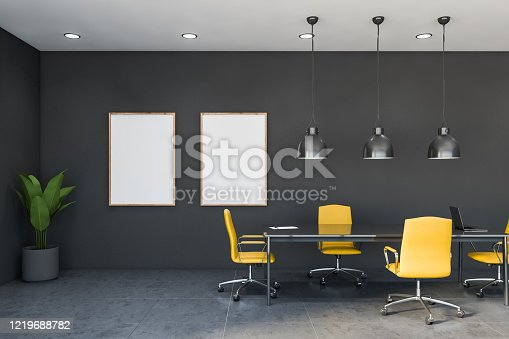 847512708 istock photo Yellow and gray conference room with poster 1219688782