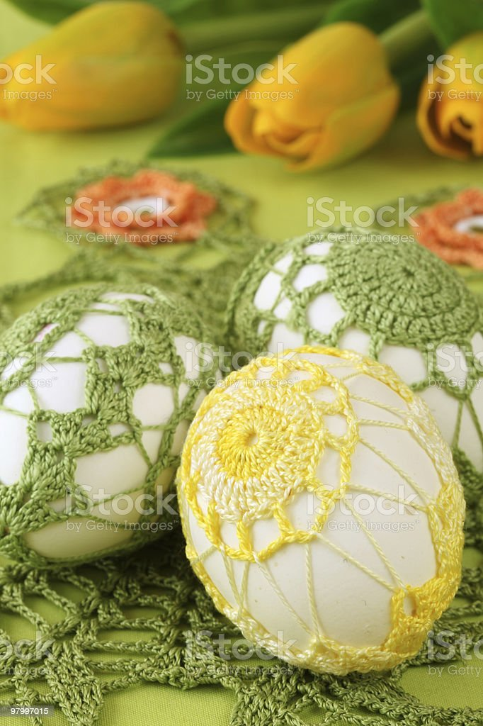 Yellow and green crochet Easter eggs royalty-free stock photo