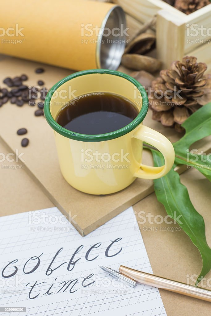yellow and green cup of coffee stock photo
