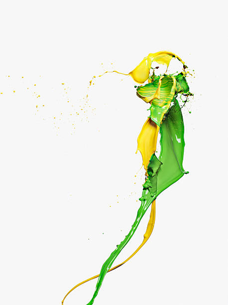 Yellow and green paint colliding stock photo