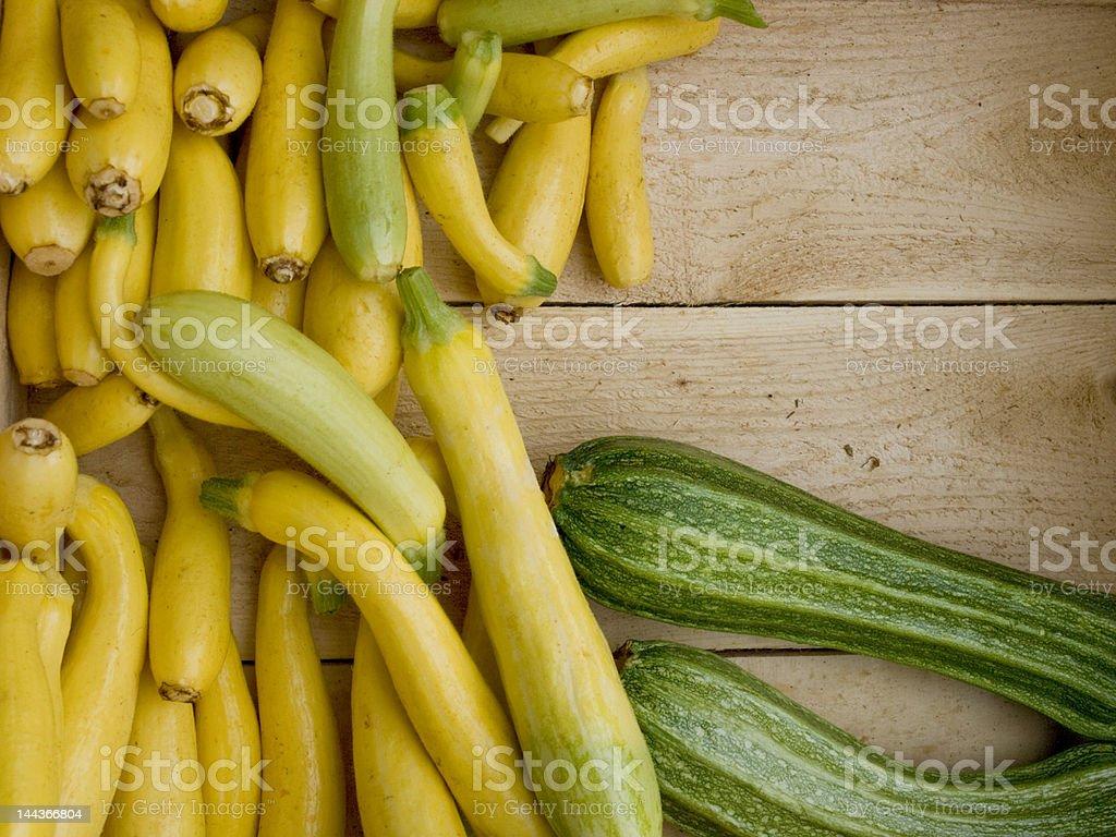 yellow and green squash at market stock photo
