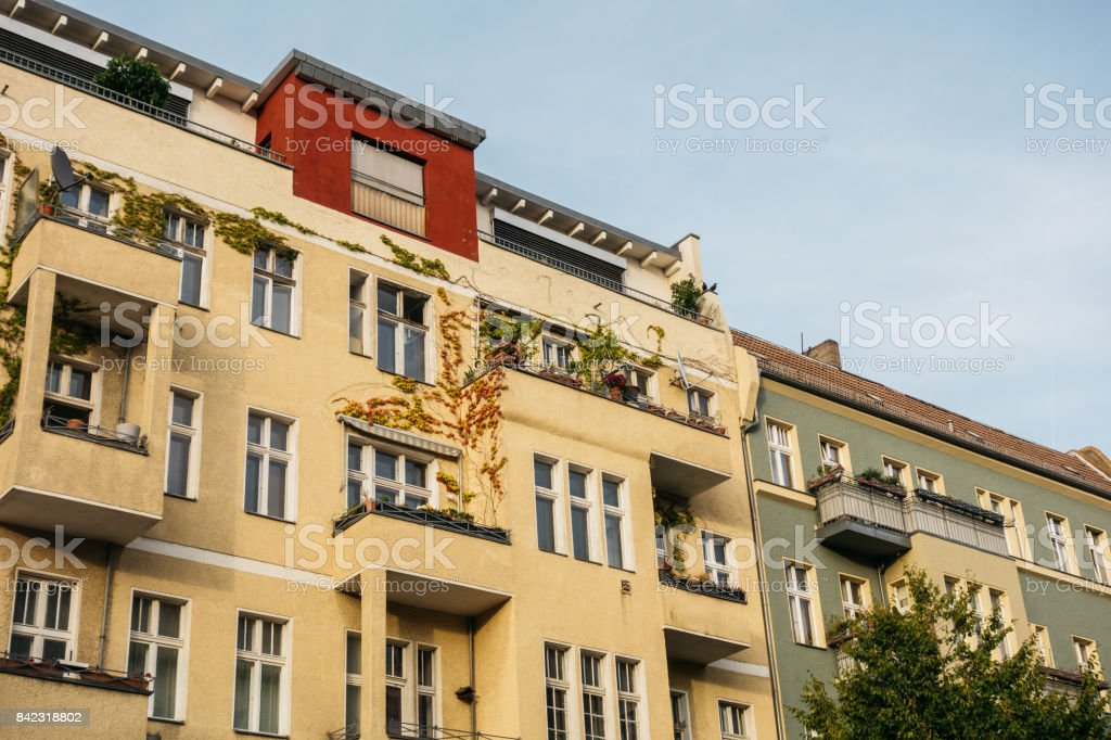 yellow and grey apartment buildings stock photo