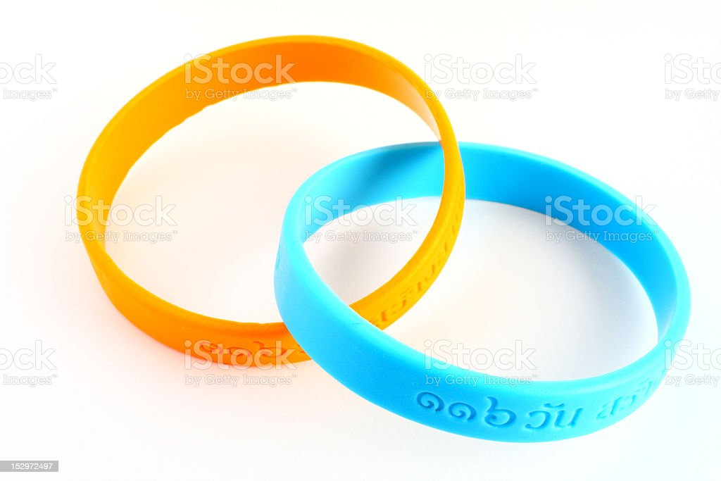 Yellow and light blue rubber bracelet. stock photo