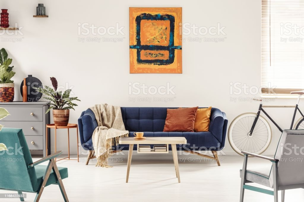 Yellow And Navy Blue Painting Above Sofa In Colorful Living Room Stock Photo Download Image Now Istock