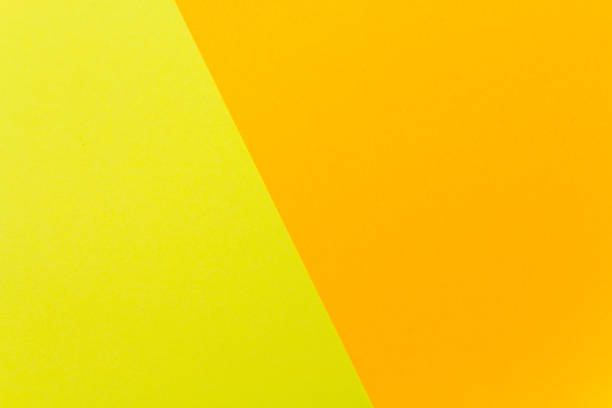 Yellow and orange color texture paper background. Geometric paper background, pastel colors . stock photo