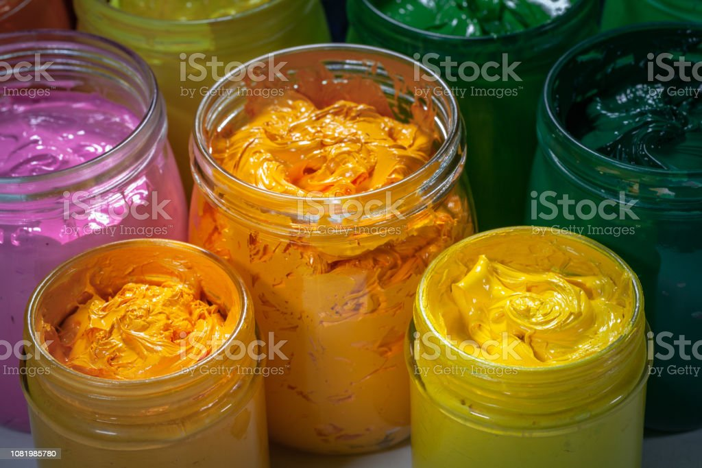 yellow and orange colors of screen printing ink for print on tee...