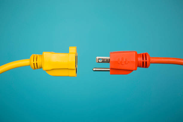 yellow and orange electric plug - disconnect stock pictures, royalty-free photos & images
