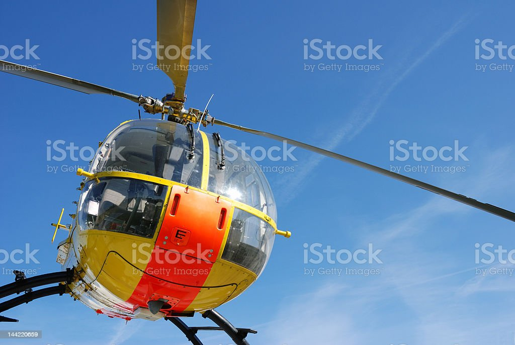 yellow and orange rescue helicopter stock photo