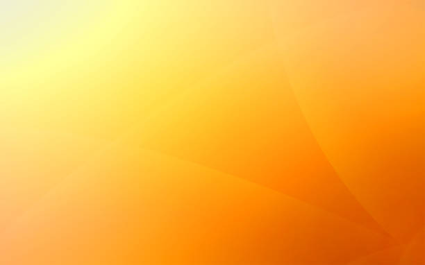Yellow and orange unusual background with subtle rays of light stock photo