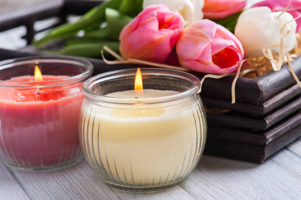 yellow and pink aroma candles with tulips - scented stock photos and pictures