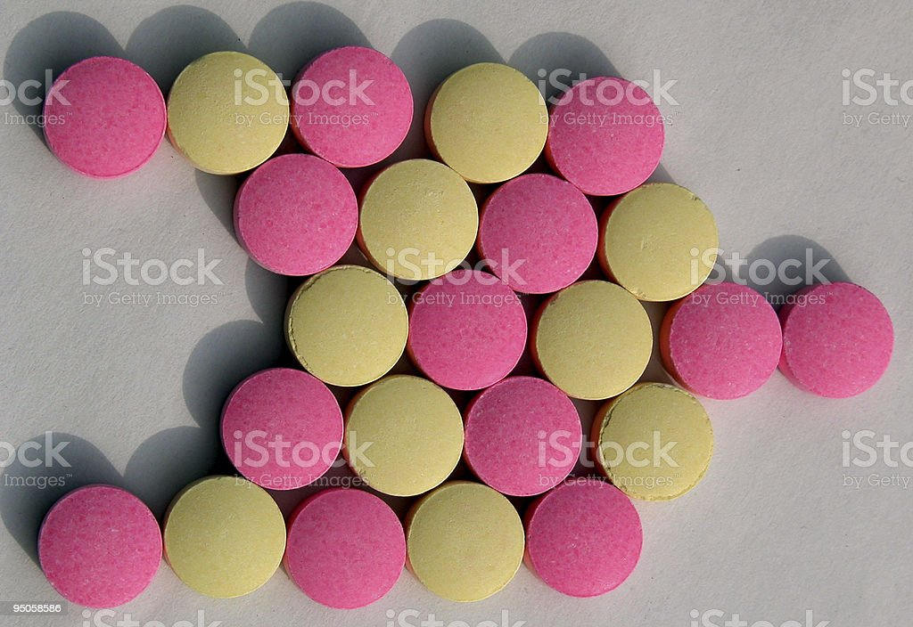 yellow and pink circle objects arranged as a right arrow stock photo