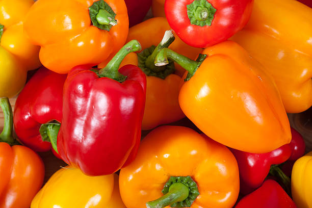 yellow and red bell pepper stock photo