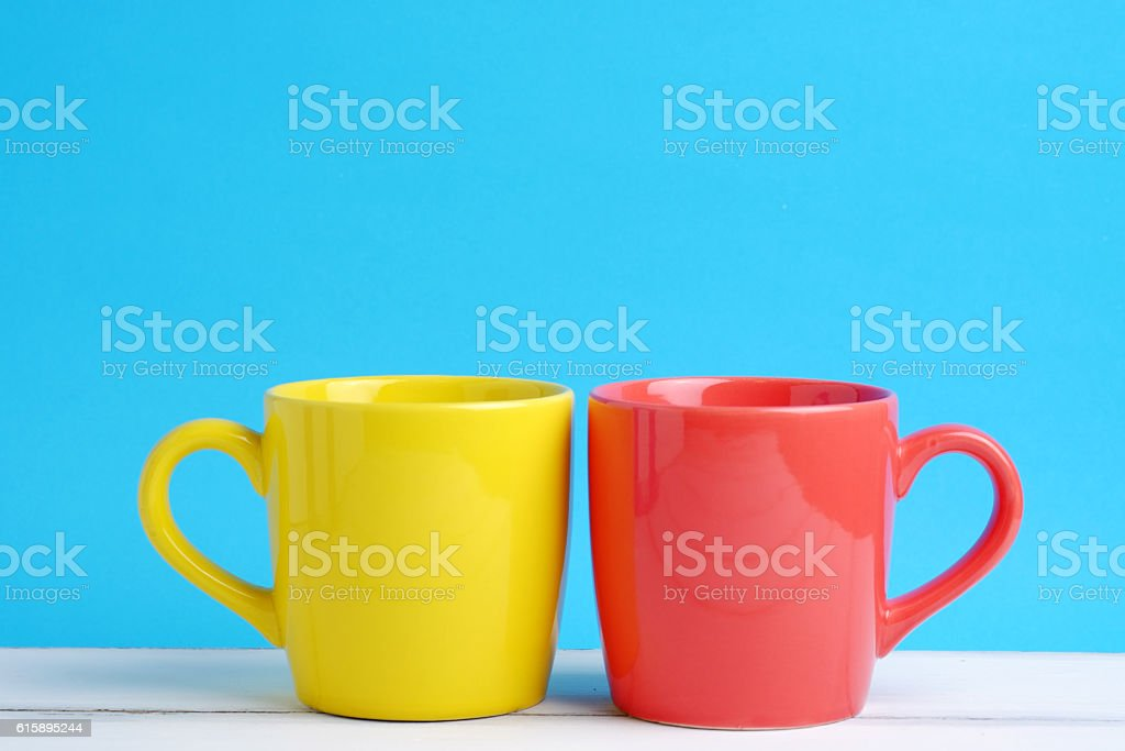Yellow and red cup. stock photo